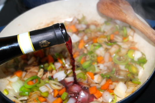 Adding the wine, the meat is cheap so be sure to use a decent bottle of wine.. If you wouldn't drink it don't cook with it!